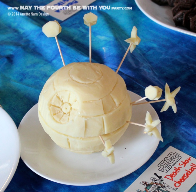 Star Wars Food: Carved Death Star Cheese Ball with X-Wings and TIE fighters /// Check out our blog for lots of Star Wars Party food recipes and downloadable labels! Great for a Birthday Party or a May the Fourth be with you Party. /// #starwars #starwarsparty #maythefourthbewithyou #starwarsbirthday #starwarsfood #cheese #deathstar #xwing #tiefighter maythefourthbewithyoupartyblog.com
