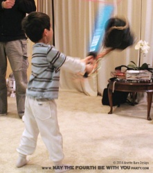 Darth Vader Piñata and Lightsaber// Check out our blog for lots more Star Wars ideas. // #starwars #starwarsparty #maythefourthbewithyou #starwarsbirthday #lightsaber #pinata maythefourthbewithyoupartyblog.com