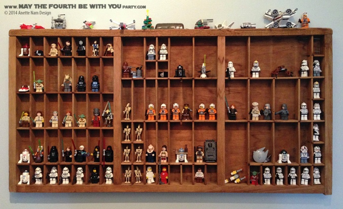 Star Wars Lego Mini-figs in Printer's Shelf // Check out our blog for lots more Star Wars decor. // #starwars #starwarsparty #maythefourthbewithyou #starwarsbirthday #legominifigs #lego maythefourthbewithyoupartyblog.com