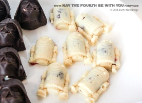 Star Wars Food: Darth Vader Chocolates with Caramel and R2D2 White Chocolates with Jam (from silicone mold) /// Check out our blog for lots of Star Wars Party food recipes and downloadable labels! Great for a Birthday Party or a May the Fourth be with you Party. /// #starwars #starwarsparty #maythefourthbewithyou #starwarsbirthday #starwarsfood #darthvader #chocolate #r2d2 maythefourthbewithyoupartyblog.com