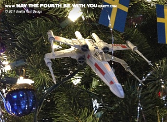 Star Wars Christmas X-Wing Ornament // Check out our blog for lots more Star Wars decor. // #starwars #starwarsparty #maythefourthbewithyou #starwarsbirthday #xwing #Christmas maythefourthbewithyoupartyblog.com