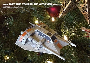 Star Wars Christmas Snow Speeder Ornament // Check out our blog for lots more Star Wars decor. // #starwars #starwarsparty #maythefourthbewithyou #starwarsbirthday #snowspeeder #Christmas maythefourthbewithyoupartyblog.com
