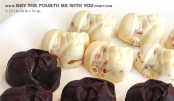 Star Wars Food: Darth Vader Chocolates with Caramel and Stormtrooper White Chocolates with Pretzels (from silicone mold) /// Check out our blog for lots of Star Wars Party food recipes and downloadable labels! Great for a Birthday Party or a May the Fourth be with you Party. /// #starwars #starwarsparty #maythefourthbewithyou #starwarsbirthday #starwarsfood #darthvader #chocolate #stormtrooper maythefourthbewithyoupartyblog.com