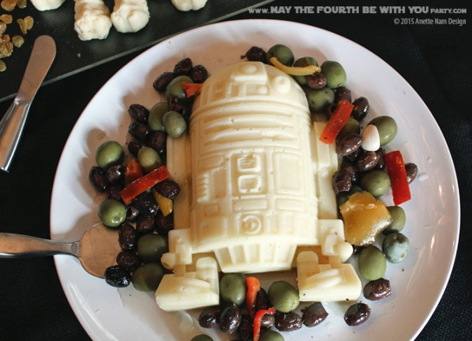 Star Wars Food: R2-D2 Mozzarella Cheese with Olive Mix (from silicone mold) /// Check out our blog for lots of Star Wars Party food recipes and downloadable labels! Great for a Birthday Party or a May the Fourth be with you Party. /// #starwars #starwarsparty #maythefourthbewithyou #starwarsbirthday #starwarsfood #r2d2 #mozzarella #olives #cheese maythefourthbewithyoupartyblog.com