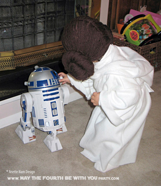 DIY Princess Leia Costume. Check out all our other Star Wars costumes on our blog! #princessleia #starwars #starwarsparty #maythefourthbewithyou #starwarsbirthday #starwarscostume #halloweencostume #leia #r2d2 #cosplay maythefourthbewithyoupartyblog.com