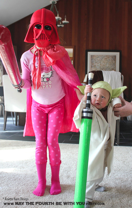 DIY Pink Girl Darth Vader and Yoda Costumes. Check out all our other Star Wars costumes on our blog! #yoda #darthvader #starwars #starwarsparty #maythefourthbewithyou #starwarsbirthday #starwarscostume #halloweencostume #cosplay maythefourthbewithyoupartyblog.com