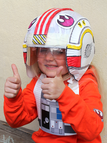 DIY Luke's X-wing pilot helmet and Costume. Check out all our other Star Wars costumes on our blog! #starwars #starwarsparty #maythefourthbewithyou #starwarsbirthday #starwarscostume #halloweencostume #luke #xwing #xwingpilot #cosplay maythefourthbewithyoupartyblog.com © filthwizardry.com