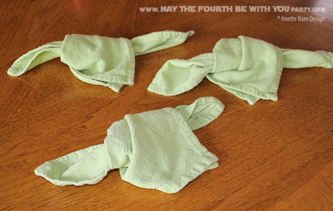 Yoda Napkins (Napkin Folding) // Check out our blog for lots more Star Wars crafts and decor. // #starwars #starwarsparty #maythefourthbewithyou #starwarsbirthday #yoda maythefourthbewithyoupartyblog.com