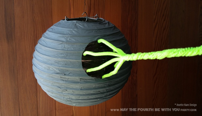 Paper Lantern Death Star // Check out our blog for lots more Star Wars crafts and decor. // #starwars #starwarsparty #maythefourthbewithyou #starwarsbirthday #banners #deathstar #paperlanter maythefourthbewithyoupartyblog.com