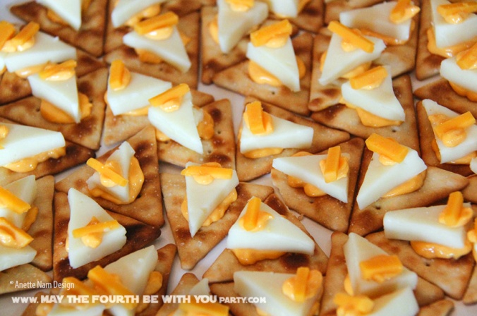 Star Wars Food: Imperial Star Destroyer Crackers with Cheese. /// Check out our blog for lots of Star Wars Party food recipes and downloadable labels!  Great for a Birthday Party or a May the Fourth be with you Party. /// #starwars #starwarsparty #maythefourthbewithyou #starwarsbirthday #starwarsfood #stardestroyer maythefourthbewithyoupartyblog.com