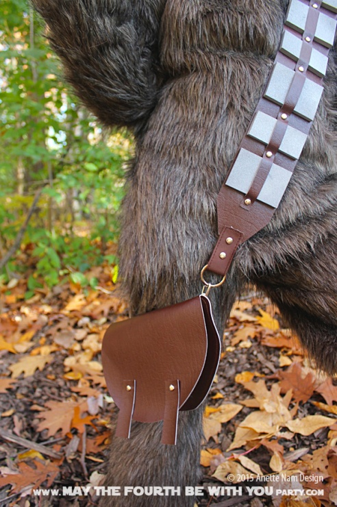DIY Chewbacca/Wookiee Bandolier and Bag. Check out all our other Star Wars costumes on our blog! #chewbacca #starwars #starwarsparty #maythefourthbewithyou #starwarsbirthday #starwarscostume #halloweencostume #wookiee #cosplay maythefourthbewithyoupartyblog.com