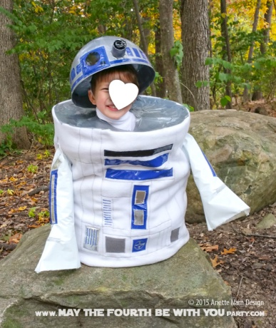 DIY R2D2 costume. Check out all our other Star Wars costumes on our blog! #r2d2 #starwars #starwarsparty #maythefourthbewithyou #starwarsbirthday #starwarscostume #halloweencostume #cosplay maythefourthbewithyoupartyblog.com