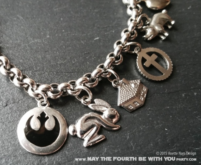 Star Wars Charm Bracelet and Jewelry/// Check out our blog for lots of Star Wars gift ideas /// #starwars #starwarsgift #maythefourthbewithyou #starwarsbirthday #jewelry #christmaspresent #starwarsjewelry #rebels #empire #silver #stainlesssteel #charm #charmbracelet maythefourthbewithyoupartyblog.com