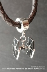 Star Wars Charm Bracelet and Jewelry/// Check out our blog for lots of Star Wars gift ideas /// #starwars #starwarsgift #maythefourthbewithyou #starwarsbirthday #jewelry #christmaspresent #starwarsjewelry #tiefighter #silver #stainlesssteel #charm #charmbracelet maythefourthbewithyoupartyblog.com
