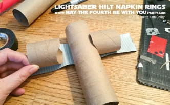 DIY Star Wars Lightsaber Hilt Napkin Rings with Napkin Lightsabers / We add new Star Wars crafts and fun to our blog every week! / #starwars #theforceawakens #rogueone #rebels #yoda #darthvader #luke #lukeskywalker #rey #kyloren #finn #anakin #anakinskywalker #macewindu #obiwan #obiwankenobi #darthmaul #starwarsparty #maythefourthbewithyou #party #birthday #lightsaber #napkinfolding #napkins #papertowelroll / maythefourthbewithyoupartyblog.com